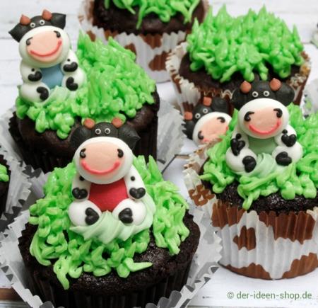 Schokoladencupcakes mit Kühen